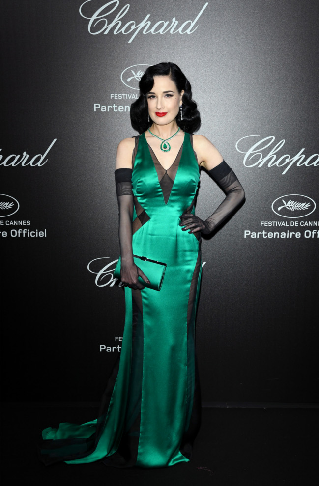 Dita Von Teese steps out wearing the beautiful Palmette Clutch.