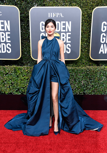 Nominated actress Gemma Chan steals the show in royal navy satin Pigalle Follies pumps