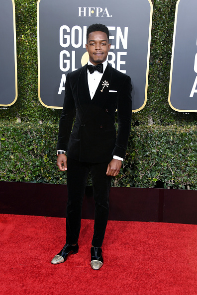 Double nominee Stephan James cutting a dashing figure in his metallic gold toe Alpha male dress shoes
